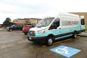A TAN healthcare van arrives to set up for COVID-19 testing at Hamshire - Fannett High School Friday. The district is offering free tests for all students and requiring them for athletes who will participate in summer workouts. Photo taken Friday, July 17, 2020 Kim Brent/The Enterprise