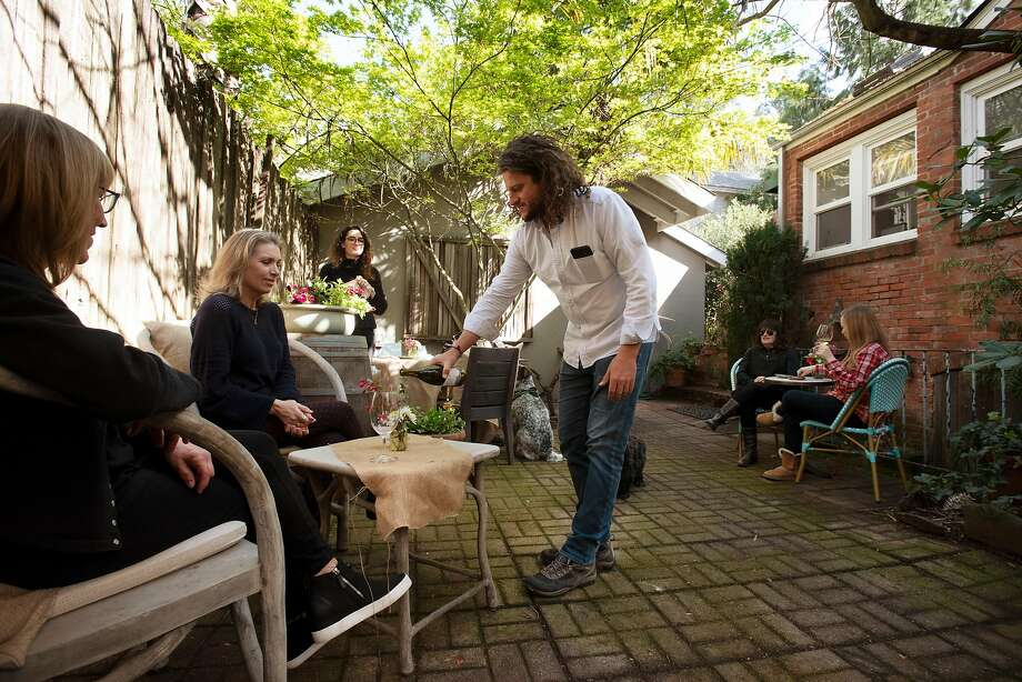 Seth Cripe, seen here in March 2020 before the COVID-19 shutdown, pours wines in the Lola tasting room's backyard. Photo: Erik Castro / Special To The Chronicle