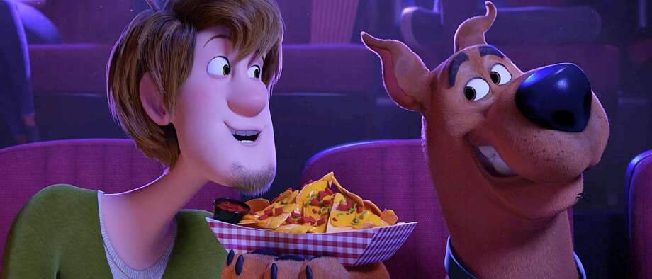"""Shaggy and Scooby travel through time and space in the animated movie """"Scoob!"""" Photo: Warner Bros. Pictures / © 2019 Warner Bros. Entertainment Inc. All Rights Reserved."""