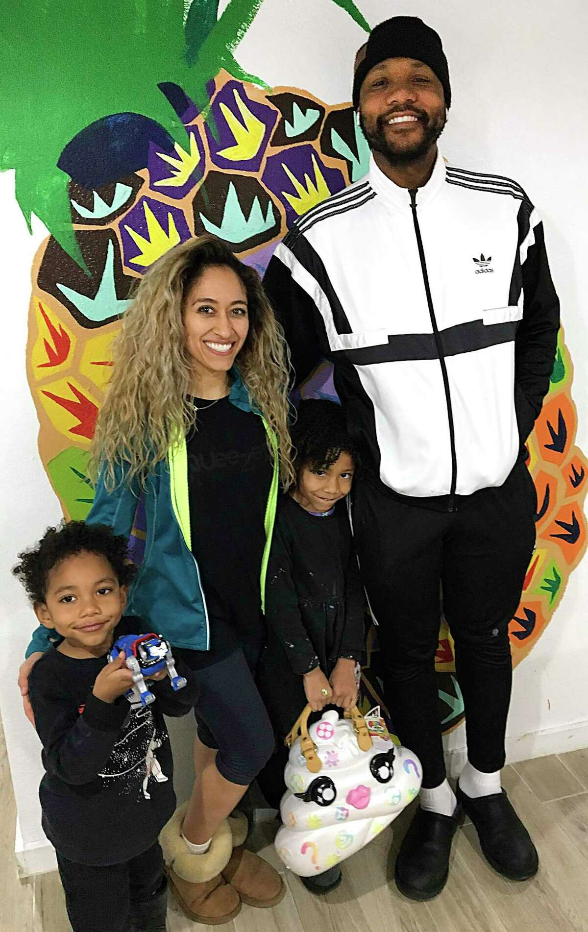 The Simpson family behind Squeezers juice bar in Southtown is opening a second location near the Pearl this summer. From left: son Kareem, mother Alexandra, daughter Aaliyah and father Keith Simpson.