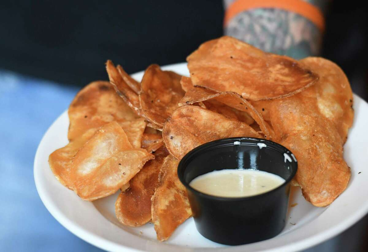 Cuomo chips sold for $1 at Harvey's Restaurant and Bar were introduced to tweak new state rules requiring food be sold with every initial drink order on Tuesday, July 21, 2020, in Saratoga Springs, N.Y. (Will Waldron/Times Union)