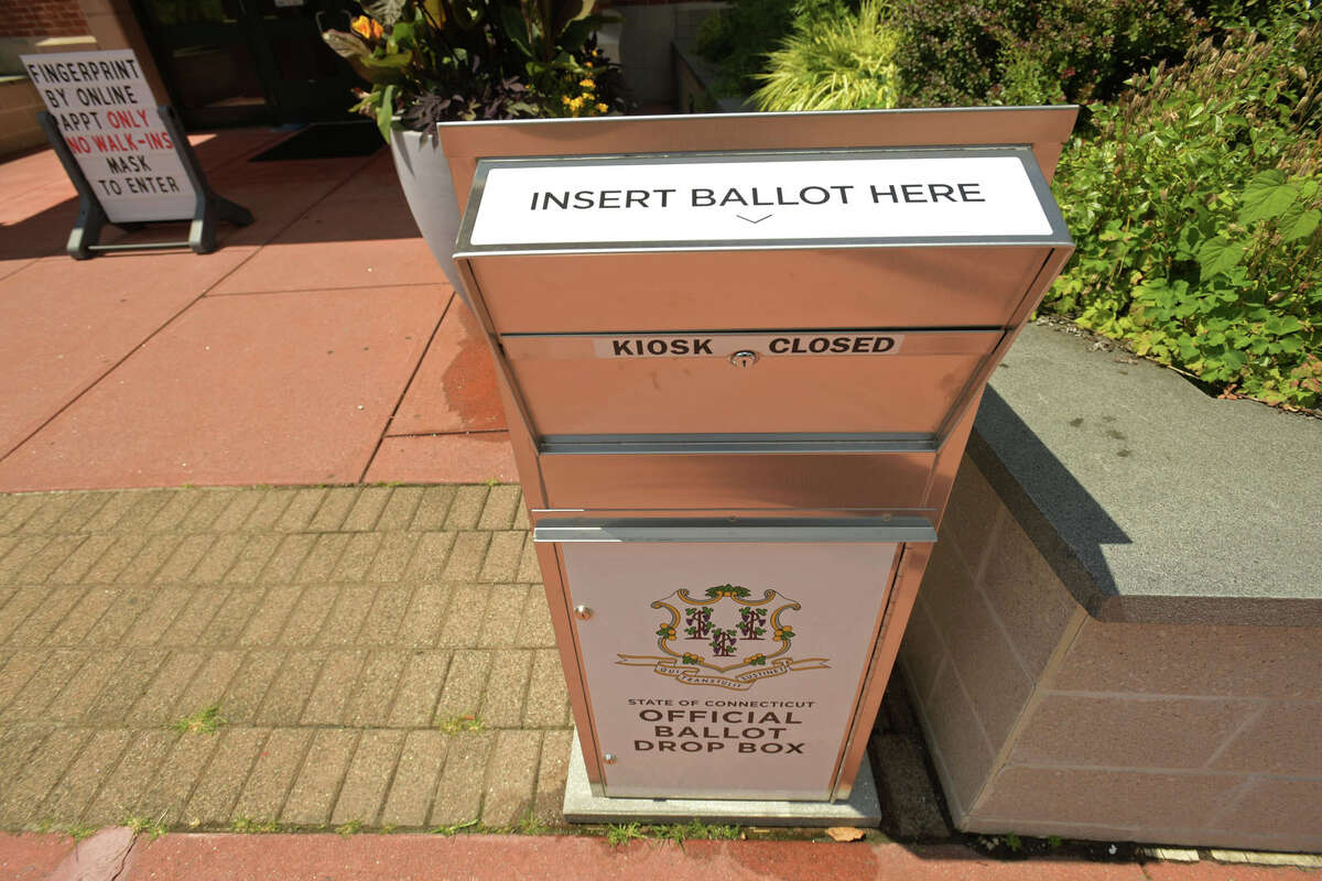 Ballot boxes have been placed in front of the Norwalk Police station Tuesday, July 21, 2020, in Nowralk, Conn. Polling stations will be open from 6 a.m. to 8 p.m. on election day. Verify your polling station here. If you vote by absentee ballot, you may track your ballot here.