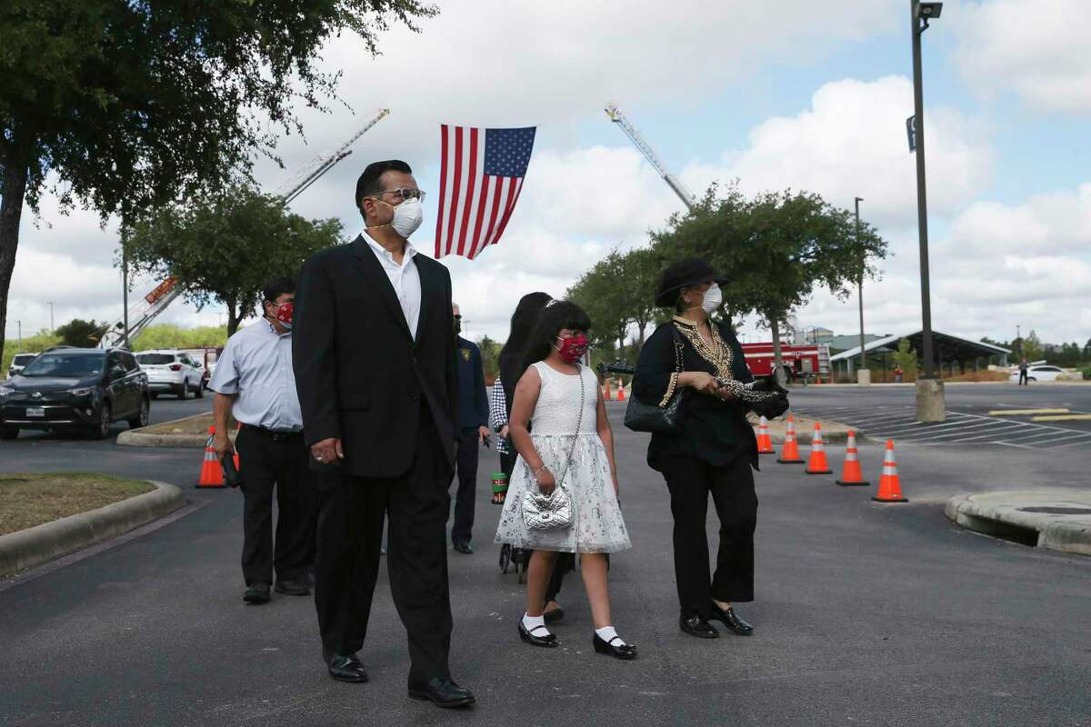 Family members escort the remains of Bexar County Sheriff's Deputy Timothy De La Fuente into Community Bible Church for funeral services, Tuesday, July 21, 2020.