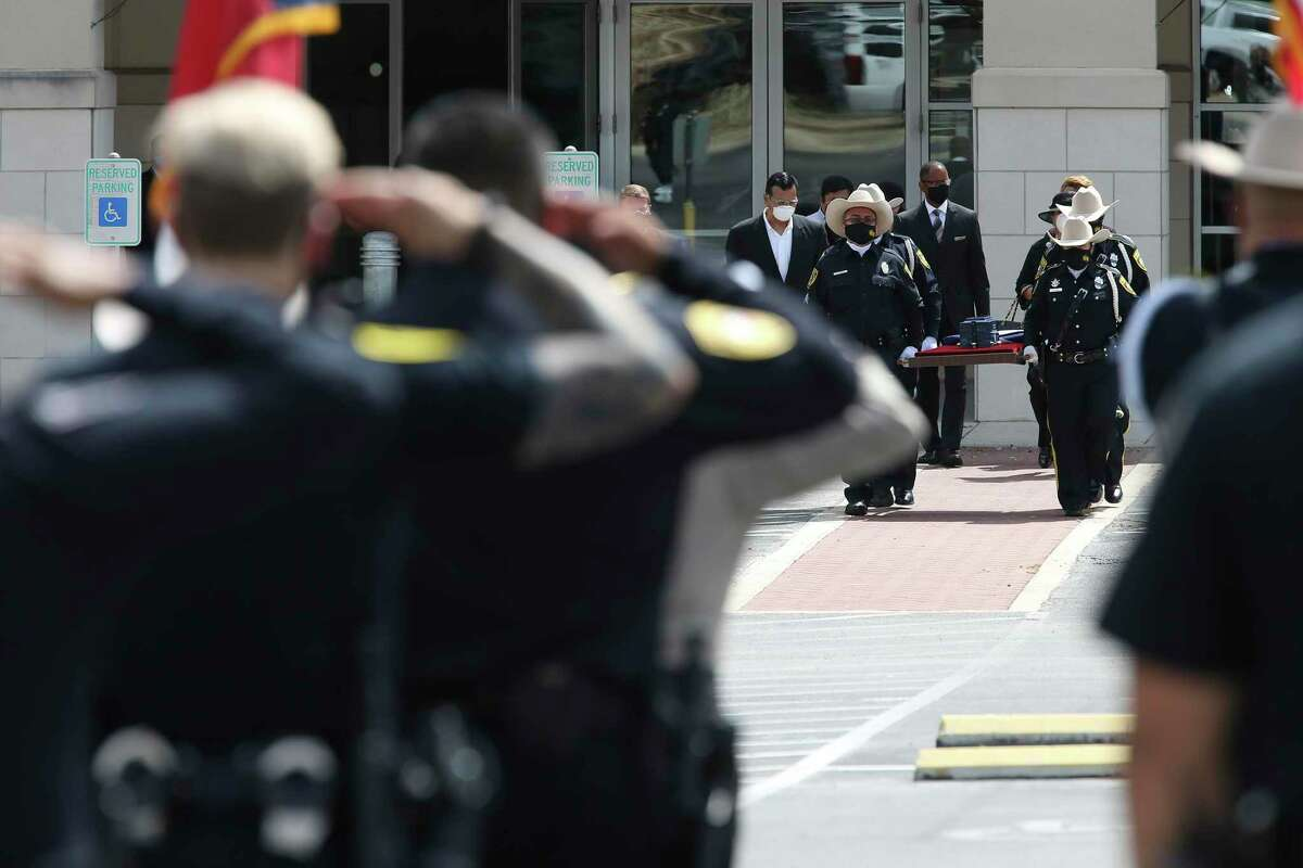 The Bexar County Sheriff's Honor Guard carries the cremated remains of Deputy Timothy De La Fuente during committal services at Community Bible Church, Tuesday, July 21, 2020. De La Fuente died on Aril 30th due to complications from COVID-19. The procession went from Mission Park South to Community Bible Church. De La Fuente was a 27-year veteran of the department and leaves behind his wife, Pauline.