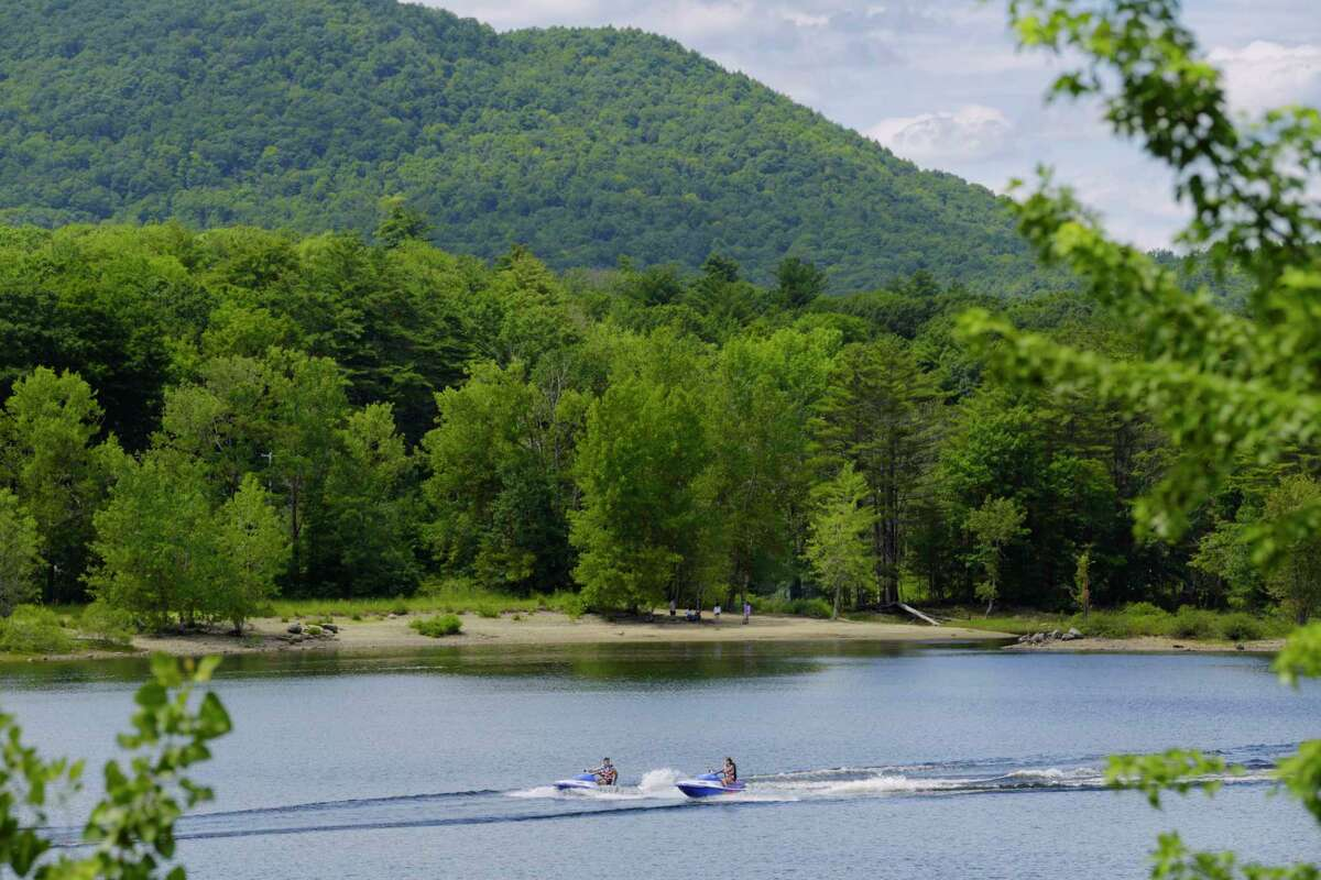 People on jet skis make their way across Great Sacandaga Lake on Tuesday, July 21, 2020, in Northville, N.Y. On Aug. 15, 2020 a swimmer was seriously injured in the area of Mosquito Bay. (Paul Buckowski/Times Union)