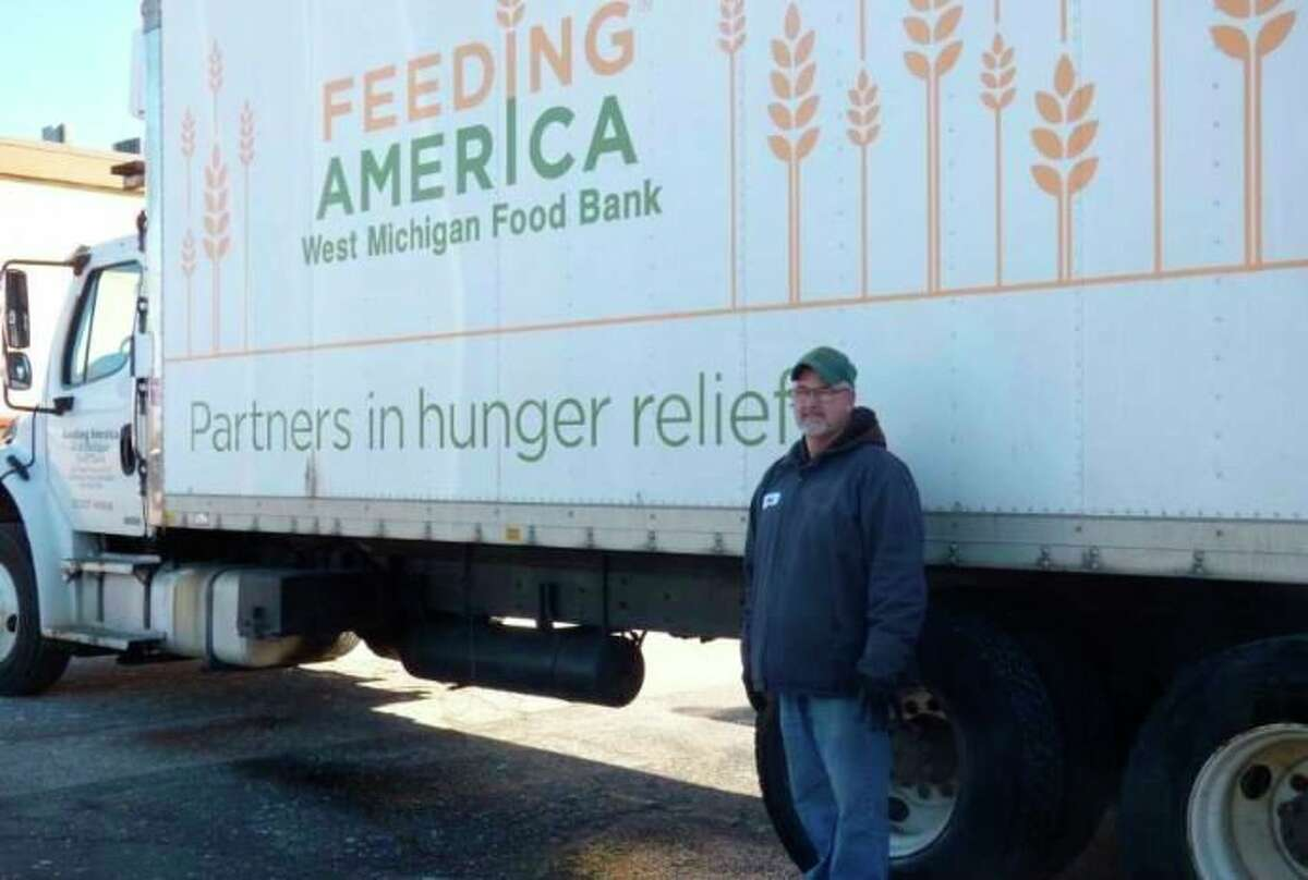Feeding America driver Jerry Grooten delivered food to the Manistee Friendship Society food pantryearlier this year. (File photo)
