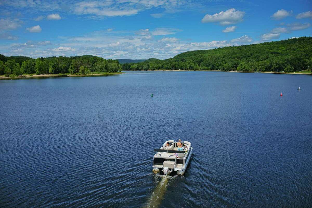 A woman pilots a boat north on Great Sacandaga Lake on Tuesday, July 21, 2020, in Northville, N.Y. (Paul Buckowski/Times Union)