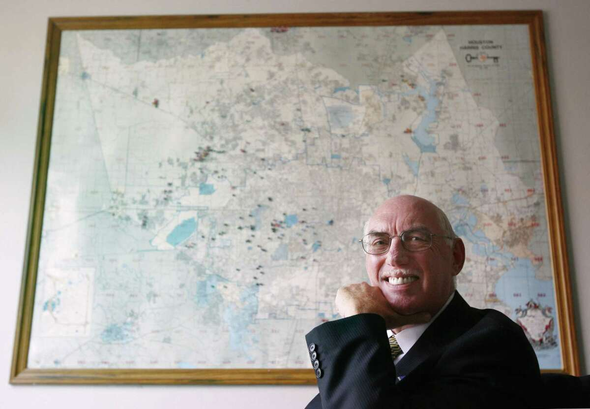 David Regenbaum, chairman and CEO of Association Management, Inc. in Houston, a company that manages homeowners associations poses in front of a map depicting the locations of associations managed by AMI.
