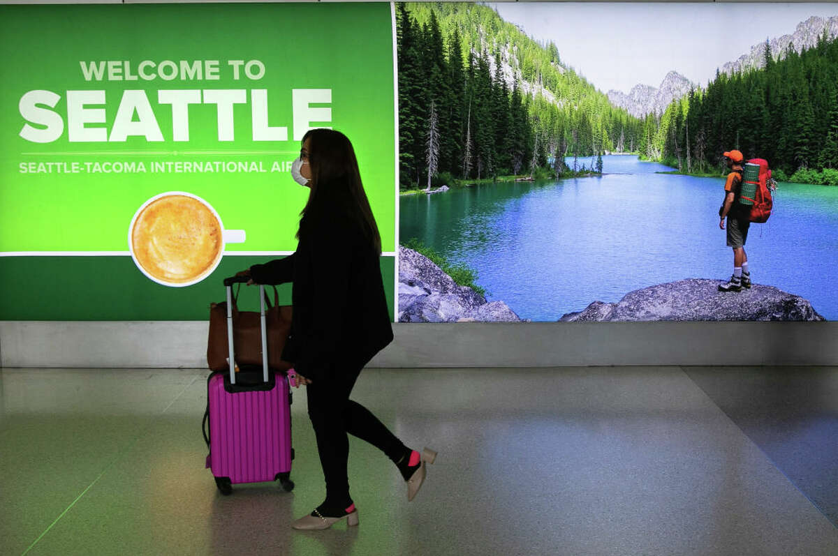 SEATTLE, WA - MARCH 15: A traveler passes through the Seattle-Tacoma International Airport on March 15, 2020 in Seattle, Washington. (Photo by John Moore/Getty Images)