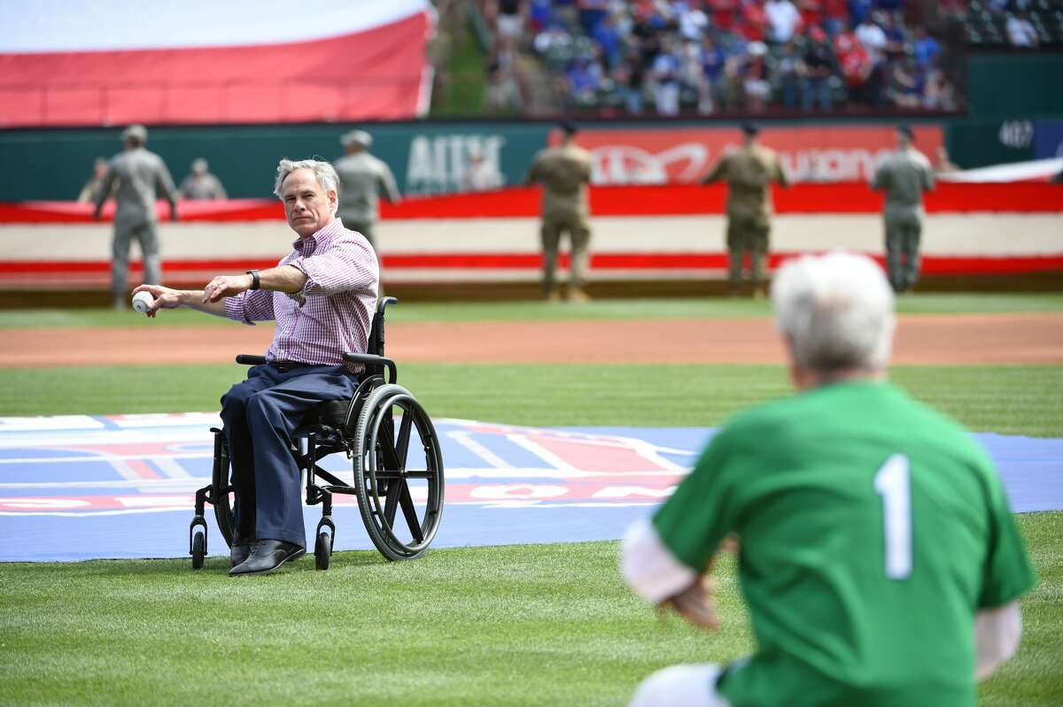 ARLINGTON, TX - MARCH 28: Texas Governor Greg Abbott throws out the ceremonial first pitch before the game between the Chicago Cubs and the Texas Rangers at Globe Life Park in Arlington on Thursday, March 28, 2019 in Arlington, Texas. (Photo by Cooper Neill/MLB via Getty Images)
