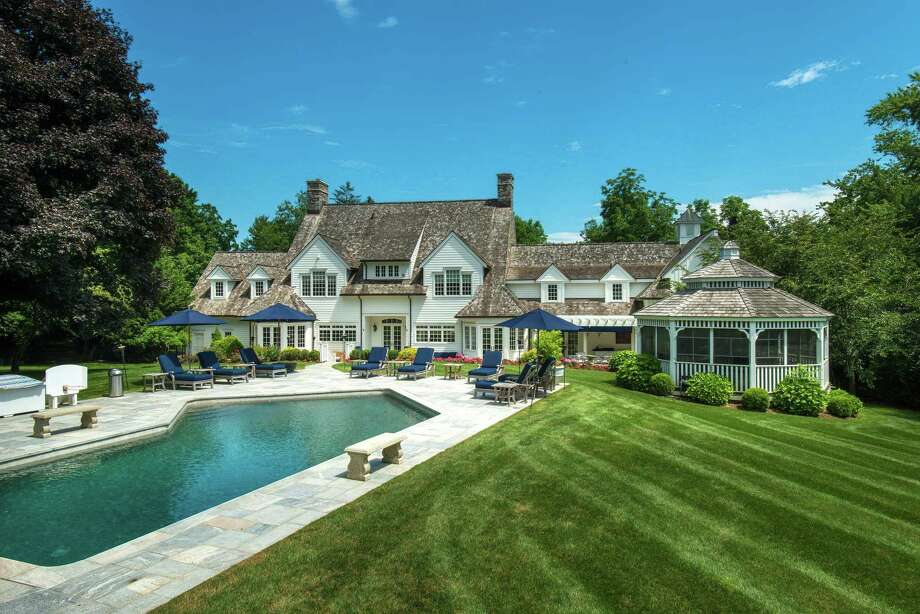"""The custom-built stone and shingle colonial house at 345 Greens Farms Road sits on a two-acre park-like property. The listing agents said it best when they characterized this two-acre park-like property and all its amenities as """"Your own private summer camp and resort-style vacation retreat."""" It features all the elegance of a premier Westport estate and all the casual luxury of a private resort. / © SR Photo, LLC All Rights Reserved"""