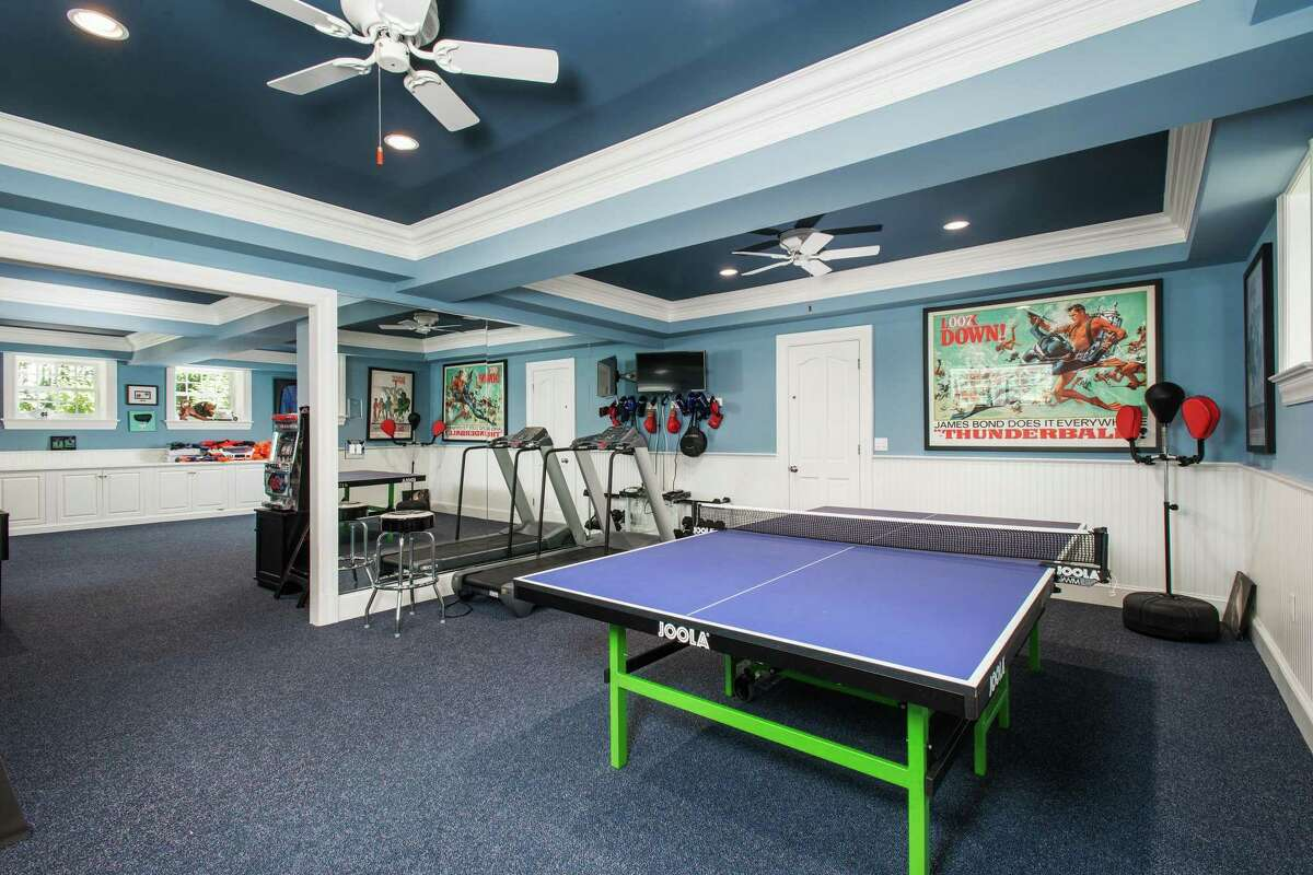 On the finished lower level there is a game room and a recreation room with an exercise area.