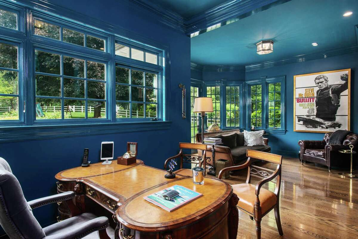 A large flexible room has multiple purposes, one of which could be as an office. While the exterior is casual and relaxing the interior is refined and tasteful.