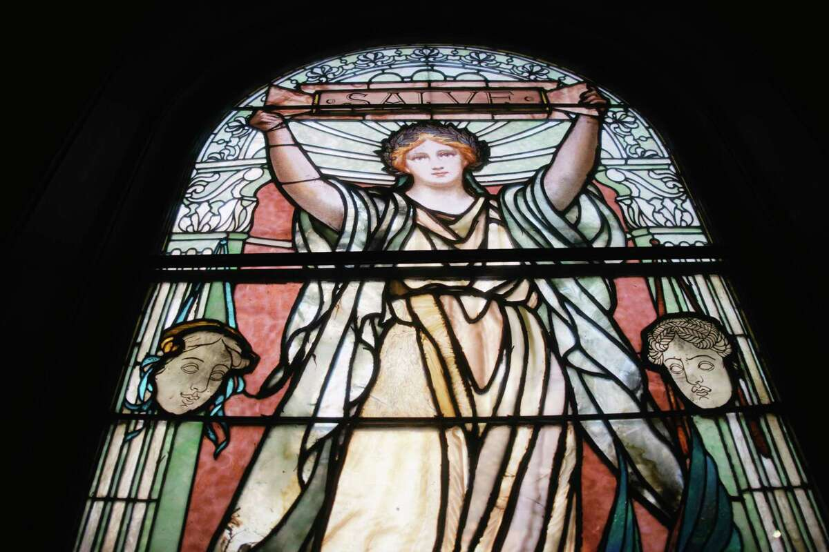 A view of one of the stained glass windows inside The Castle, the nickname for the former Pi Kappa Phi fraternity house, on Tuesday, July 21, 2020, in Troy, N.Y. (Paul Buckowski/Times Union)