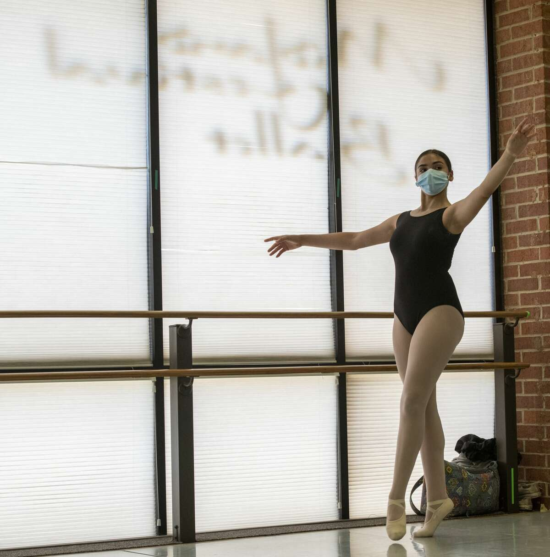 Addison Garcia practices ballet while wearing masks Tuesday, July 21, 2020 at Midland Festival Ballet. Jacy Lewis/Reporter-Telegram