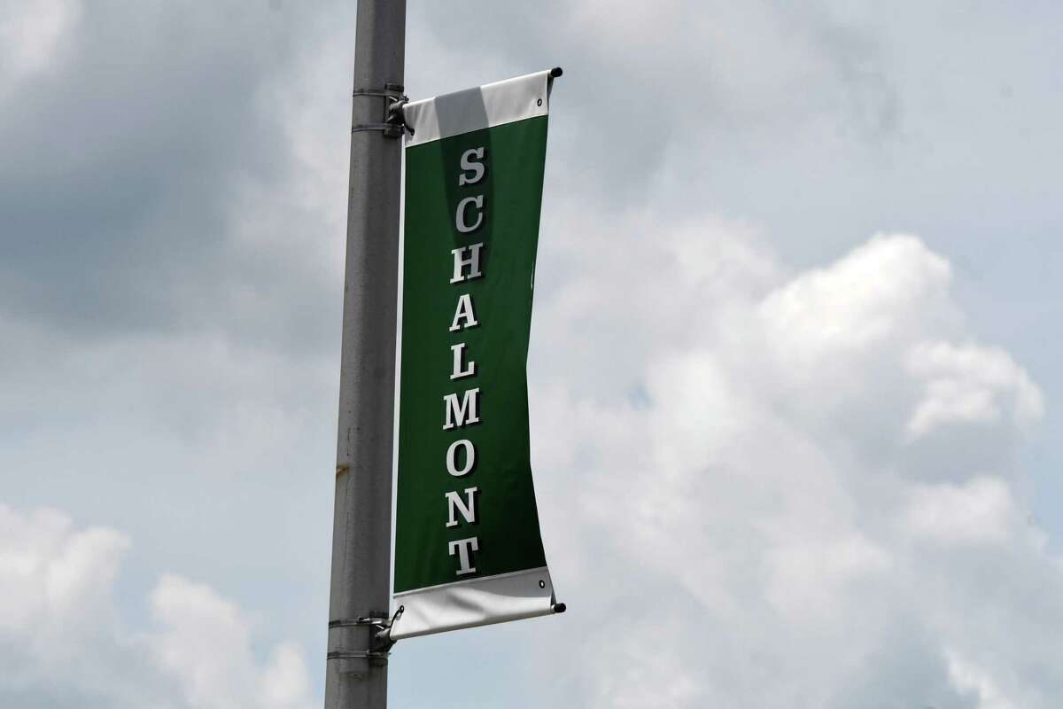 School flags fly outside Schalmont High School on Monday, July 20, 2020, in Rotterdam, N.Y. (Will Waldron/Times Union)