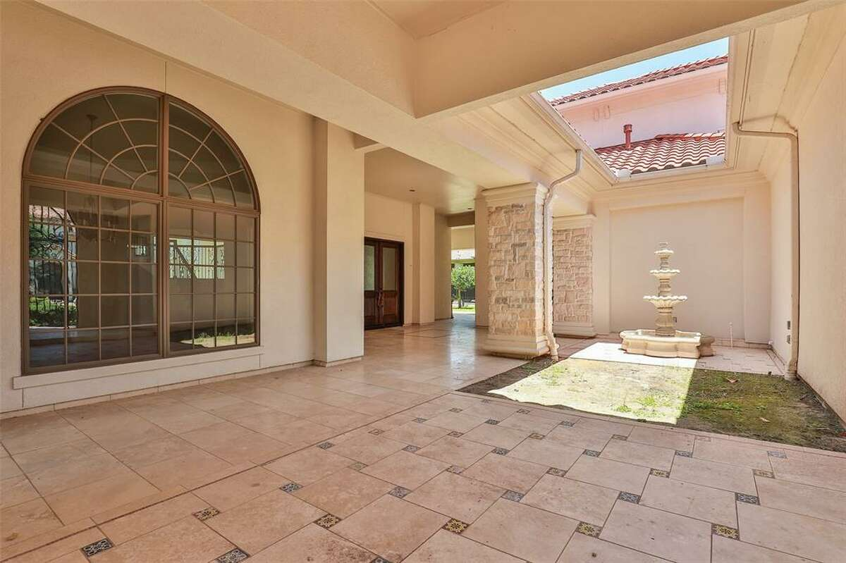 Beyond the front gate is an enclosed patio.