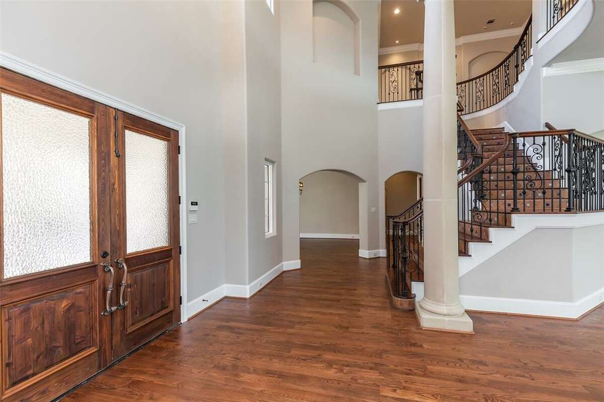 A winding staircase leads to a massive game room.