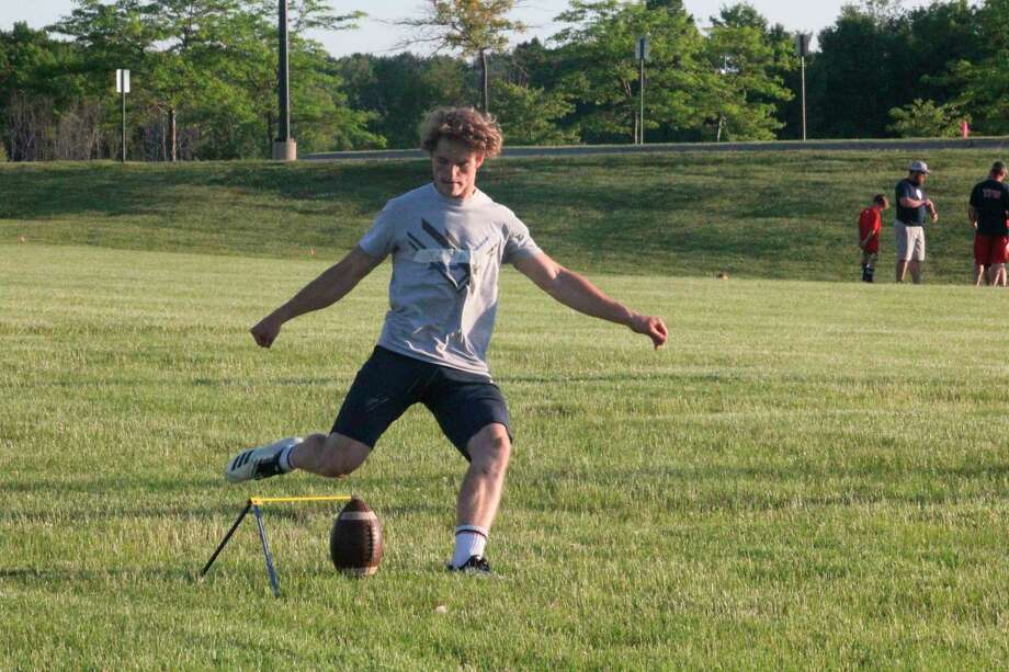 Big Rapids' Sam Alley works on his placekicking during a summer conditioning workout. (Pioneer photo/John Raffel)