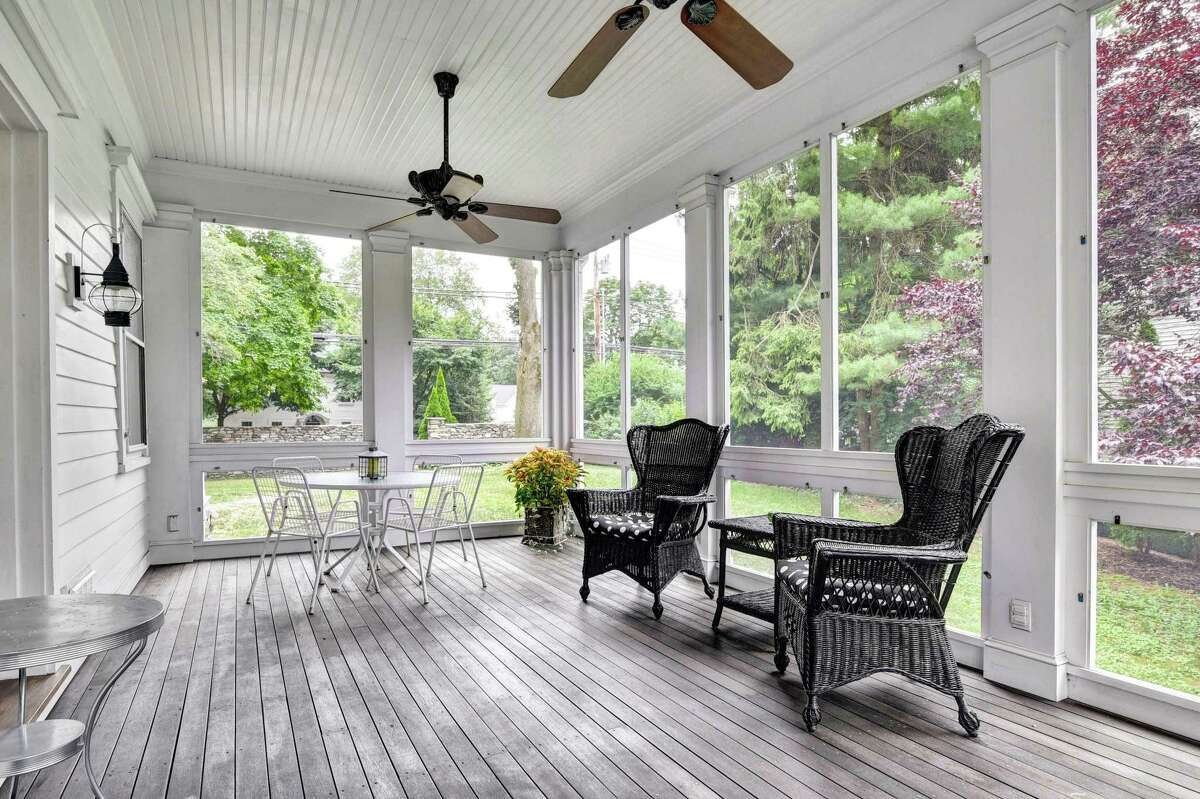 The sizable heated four-season porch has removable glass panels.