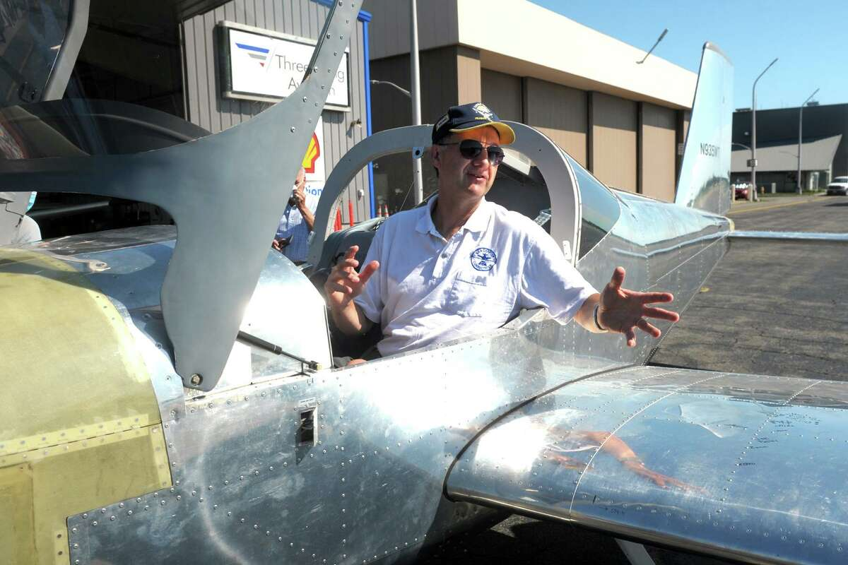 Pilot Mark Scott of the Spirit of Meriden Flight Club sits in the cockpit of a RV-12 airplane after landing at Sikorsky Memorial Airport, in Stratford, Conn. July 21, 2020. Industrial manufacturing students from Bassick High School, in Bridgeport, will soon begin building a RV-12. The Meriden club's airplane was also built by high school students.