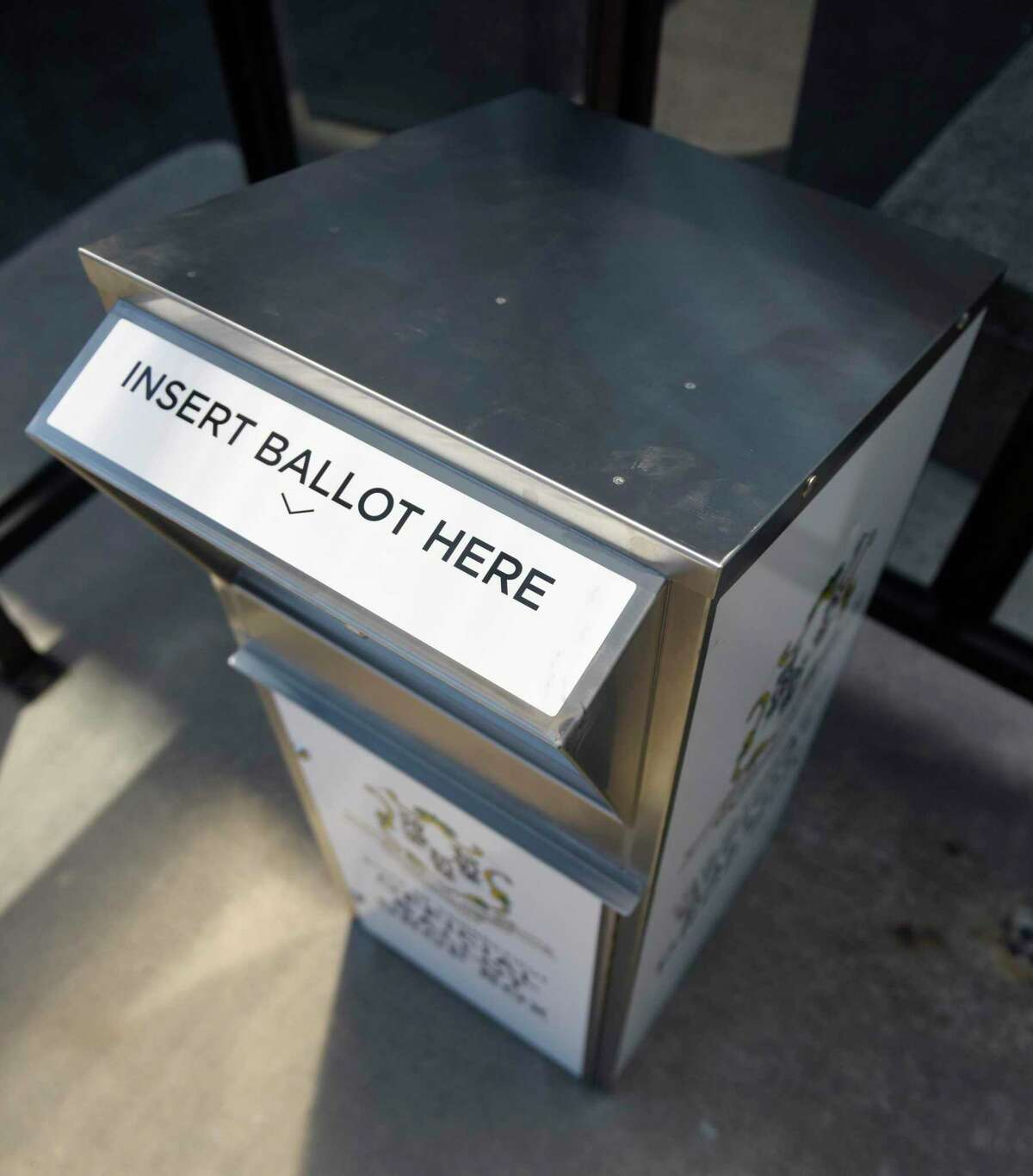 A Connecticut absentee ballot drop box is located outside Town Hall in Greenwich, Conn. Tuesday, July 21, 2020. Secure metal bins have been placed in towns throughout the state for residents to place their absentee ballot applications and absentee ballots for the upcoming primary election on Aug. 11.