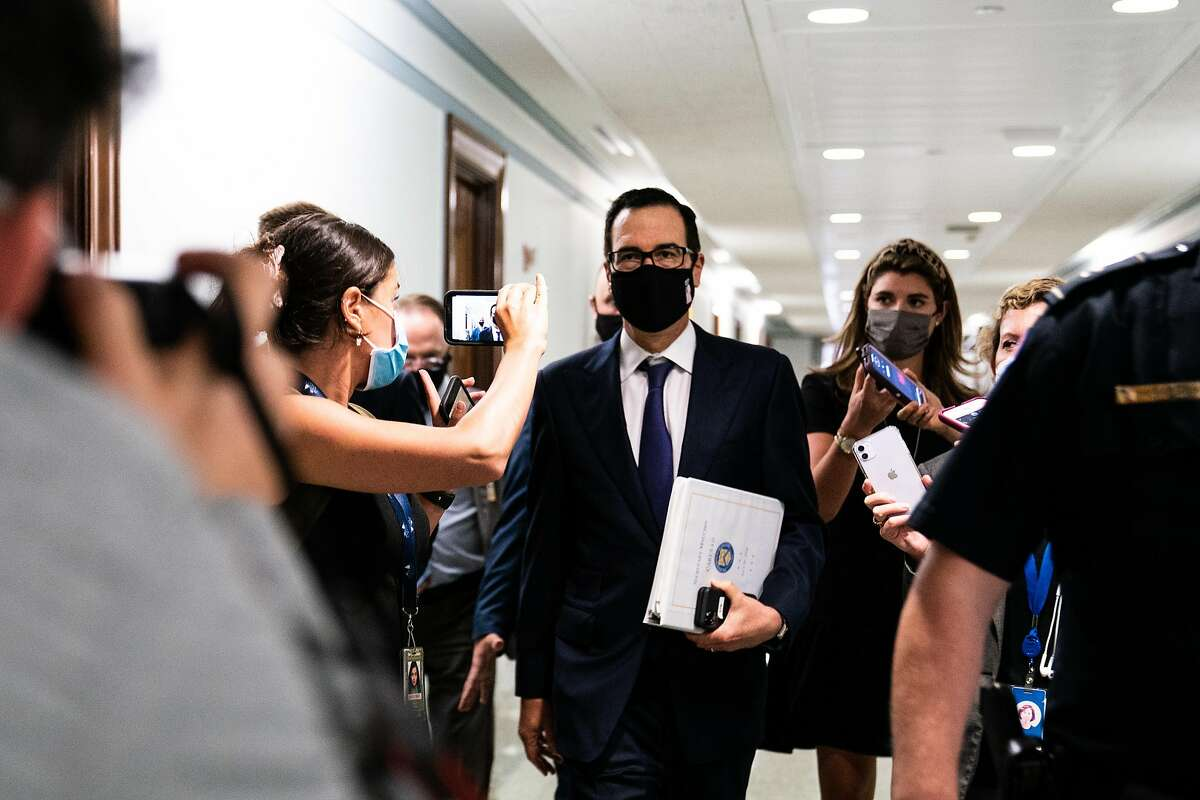Treasury Secretary Steven Mnuchin speaks with reporters after attending a Senate Republicans luncheon in Washington, on Tuesday, July 21, 2020. (Anna Moneymaker/The New York Times)
