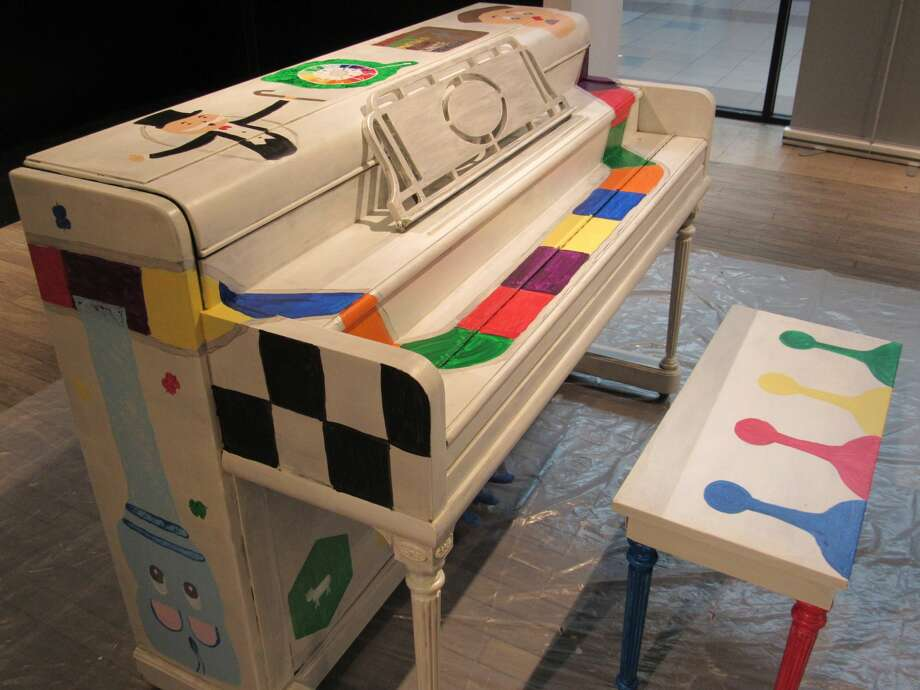 """Piano decorated by Samantha Shures. The piano will be among 14 stationed around the Midland area as a part of Public Art Midland's """"Art Plays"""" project. Photo: Victoria Ritter/vritter@mdn.net"""
