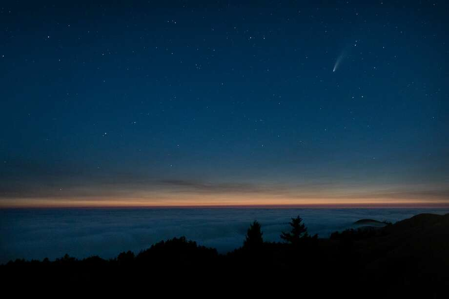 Photographer John Todd composed this image of Comet Neowise appearing just after sunset from Mount Tamalpais. Photo: Instagram /  Johntoddphotographs