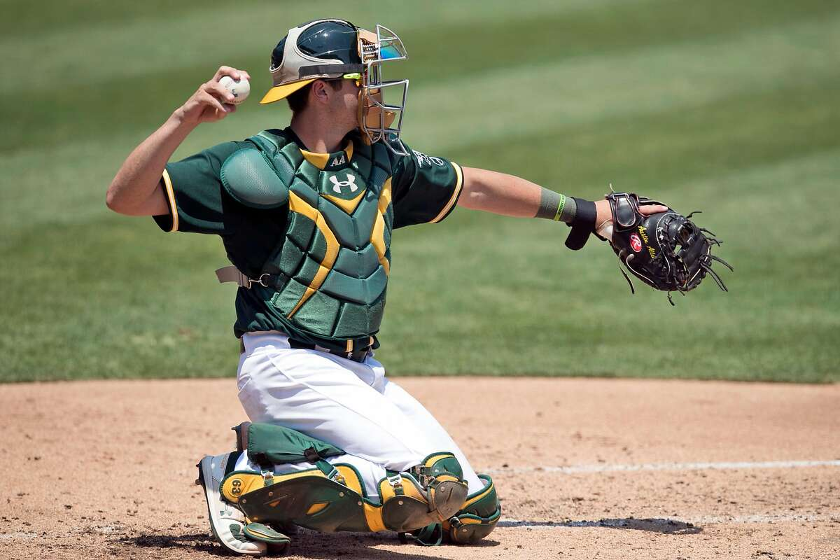A's catcher Austin Allen (30) throws to the pitcher as the Oakland Athletics played in a simulated game at the Coliseum in Oakland, Calif., on Sunday, July 19, 2020.