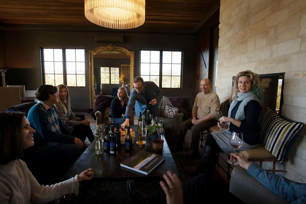 Owner Kenny Kahn, 2nd from right, with Director of Hospitality Carla Jeffries, far right, during a private tasting at the winery at Blue Rock Vineyard in Cloverdale, California. December 28, 2018.