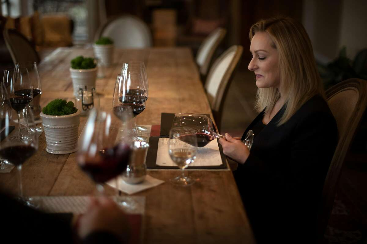 A guest admiring the wine's color during a private tasting at VŽritŽ in Healdsburg, California. January 11, 2019.