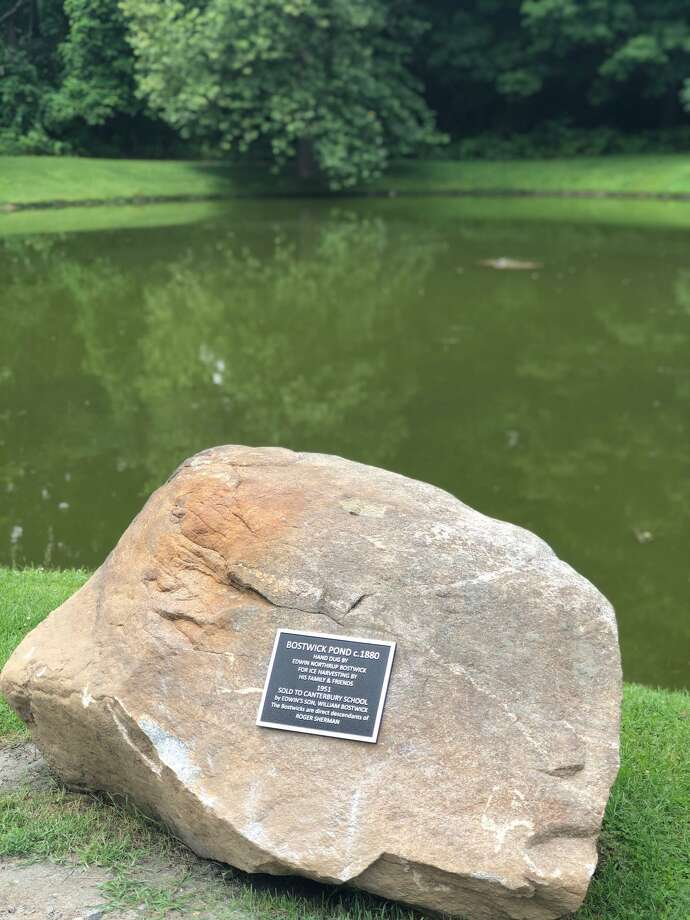 A boulder from Bostwick Farm was moved to the pond for the plaque installation. Photo: Deborah Rose /Hearst Connecticut Media / Danbury News Times