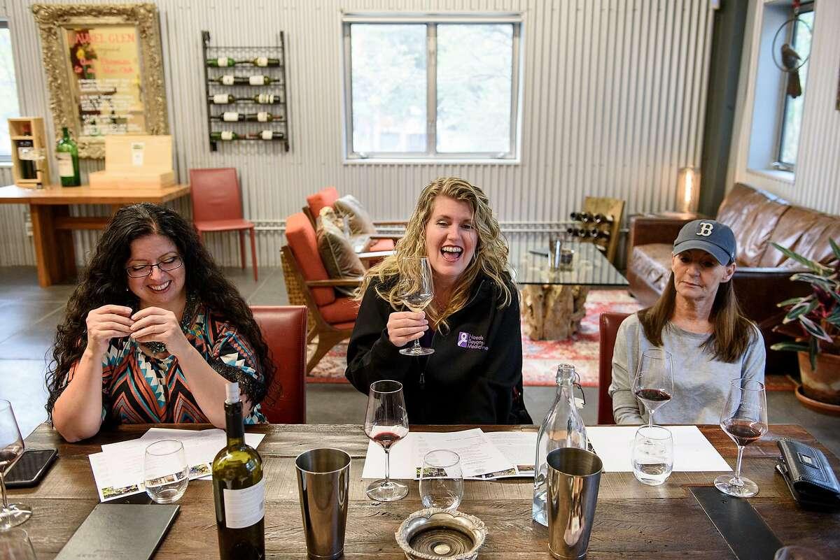 Cindy Donner, left, Nancy Reed and Jordan Crane laugh while tasting wine at Laurel Glen Vineyard's tasting room in Glen Ellen, Calif, on Friday November 9, 2018.
