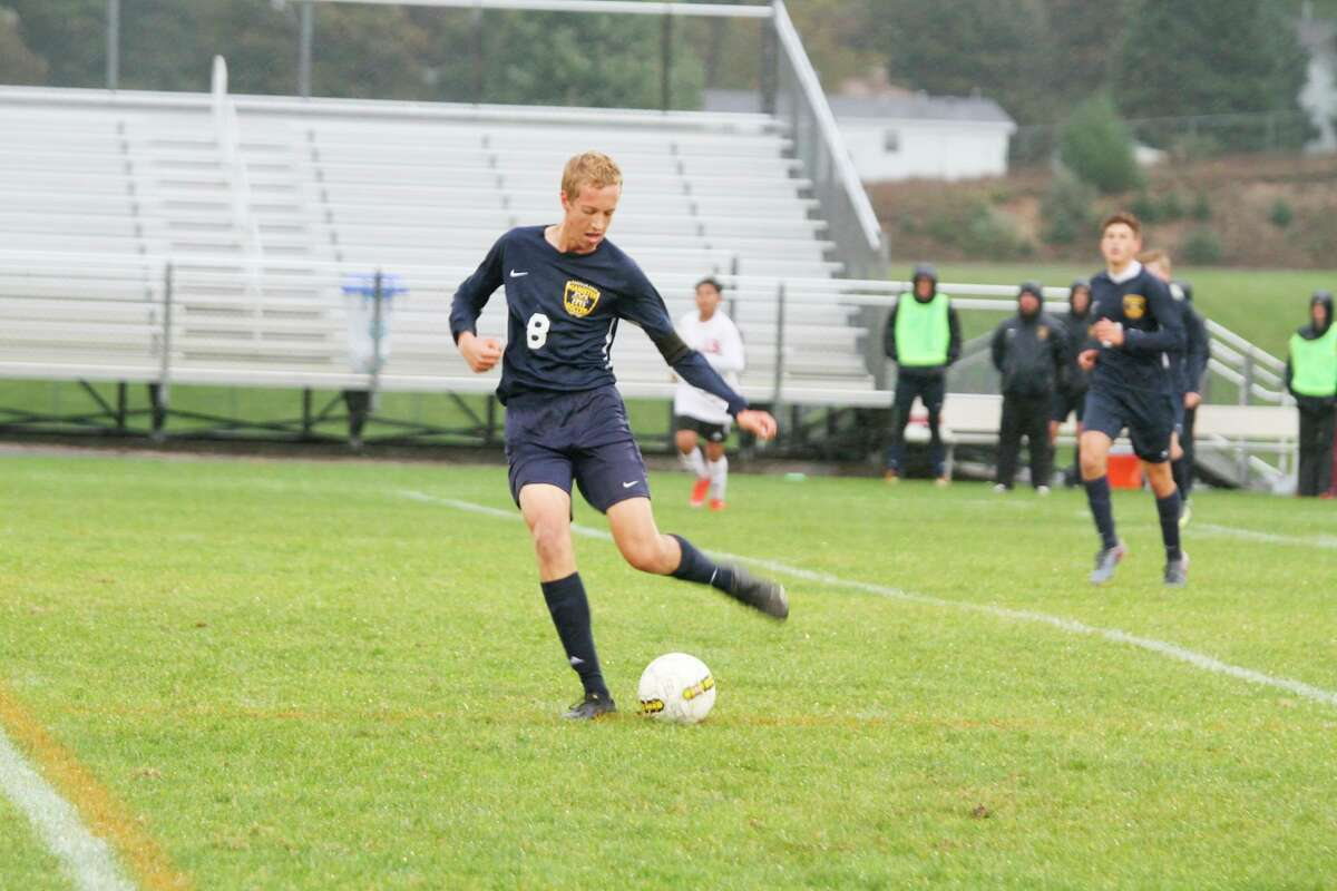 Manistee's Grant Schlaff looks to send the ball upfield while playing soccer for the Chips. (News Advocate file photo)