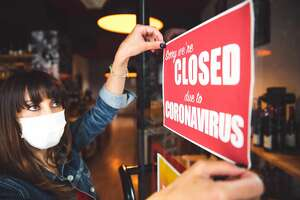 Small business closing sign due to Covid-19 coronavirus.