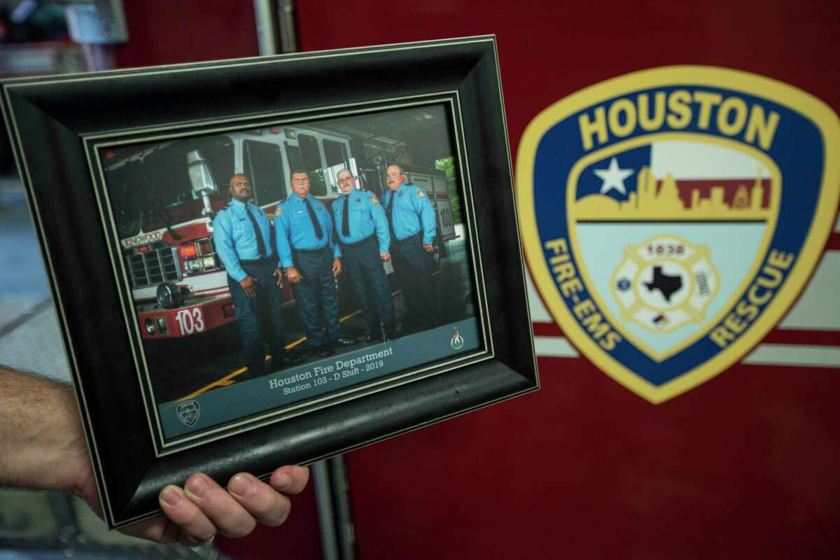 Houston Fire Capt. Leroy Lucio, second from let, is shown in a 2019 photo with his D Shift crew, from left, William Johnson, Lucio, Michael Roberts and Mike Tullis at Station 103 in Kingwood. Lucio, a 29-year veteran of the department, died Monday from COVID-19, according to Chief Sam Peña. He was battling the virus at a hospital in his hometown of San Antonio and is the first firefighter in Houston to die from the virus, the Houston Professional Fire Fighters Association said.