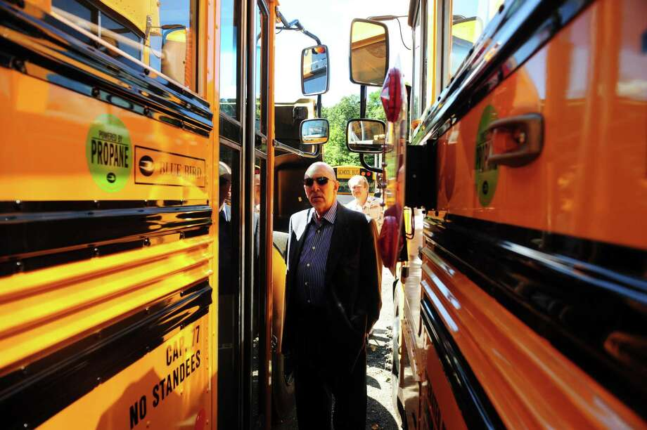 Freeman Burr, Superintendent of Schools, gets a look at Shelton's new fleet of propane-powered school buses on Aug. 15, 2013 at the city's bus depot. Photo: Autumn Driscoll / Autumn Driscoll / Connecticut Post