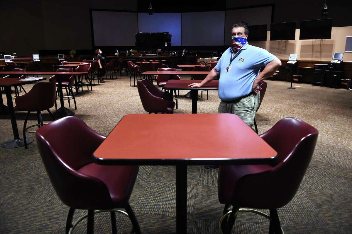 Paul DeRose, facilities director for the Connecticut OTB, is photographed inside the simulcast area of Sports Haven with reduced seating for social distancing.