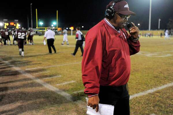 Central head football coach Andrew Washington talks with his coaches during a timeout in the final minutes of playoff action against Goose Creek Memorial at Zaharias Stadium. Friday, November 13, 2009. Valentino Mauricio/The Enterprise