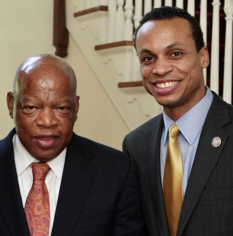 Congressman John Lewis, left, with Connecticut State Treasurer Shawn T. Wooden at Wooden's home. Photo: Contributed Photo