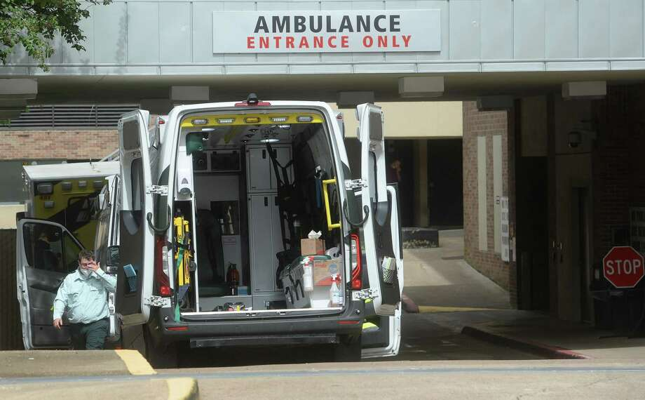 Ambulances are parked in the Emergency Room drive at Christus St. Elizabeth Hospital in Beaumont Tuesday, where crews clean and wait after making patient deliveries. Photo taken Tuesday, July 21, 2020 Kim Brent/The Enterprise Photo: Kim Brent / The Enterprise / BEN