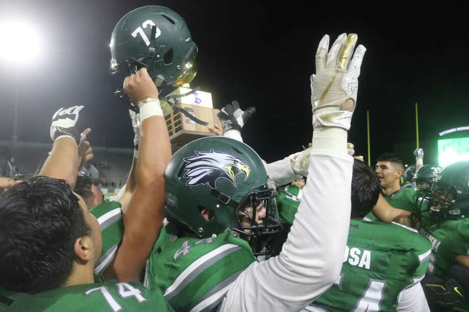 Pasadena High School football players whoop it up after winning the Pride Bowl last season. Now we may be looking at the first-ever December Pride Bowl, based on the UIL's revamped schedule that was released Tuesday. Photo: Robert Avery