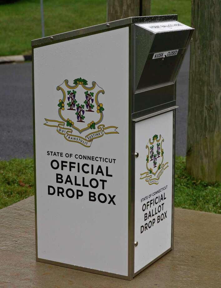 "A drop box labeled ""State of Connecticut Official Ballot Drop Box"" has been installed on a concrete pad at the corner of S King Street and Strawberry Hill Rd at the King Street Volunteer Fire Department. Friday, July 17, 2020, in Danbury, Conn. Photo: H John Voorhees III / Hearst Connecticut Media / The News-Times"