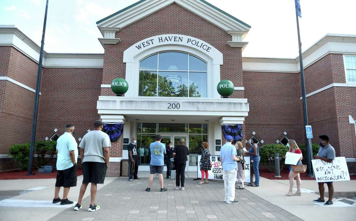 People gather in front of the West Haven Police Department to speak at a meeting of the West Haven Police Commission on July 21, 2020.