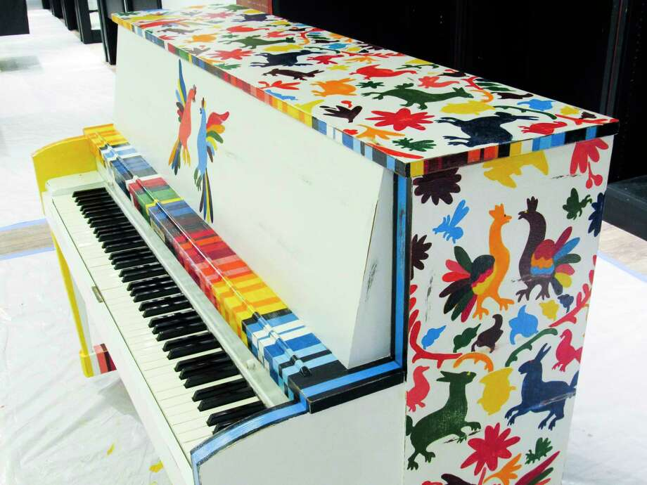 """A piano painted by Autumn Reyes and Sue Zolton as part of Public Arts Midland's """"Art Plays"""" painted piano project is seen Tuesday inside Midland Mall. The pianos will soon be transported to locations around the city, where they will be displayed through the end of the summer. (Victoria Ritter/vritter@mdn.net)"""
