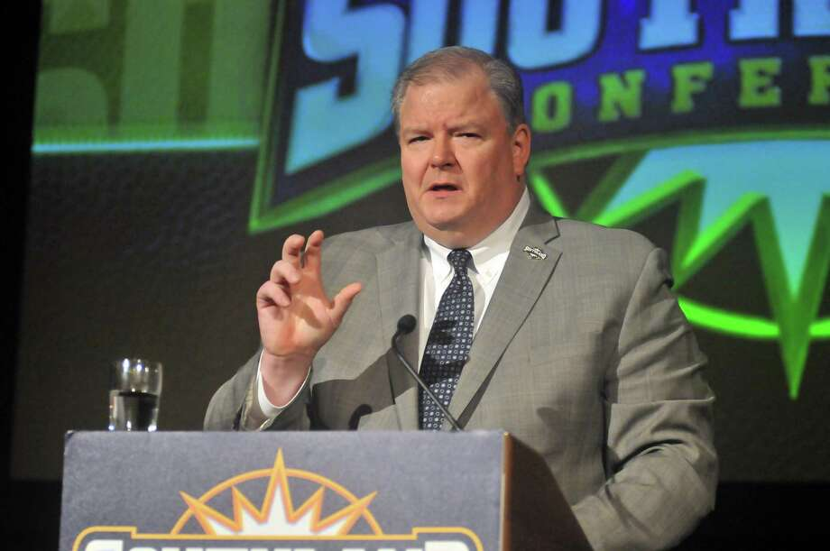 Southland Conference commissioner Tom Burnett speaks as the SLC football media day gets underway at the Hilton Houston Post Oak in Houston. Photo: Mike Tobias/The Enterprise / Mike Tobias/The Enterprise/