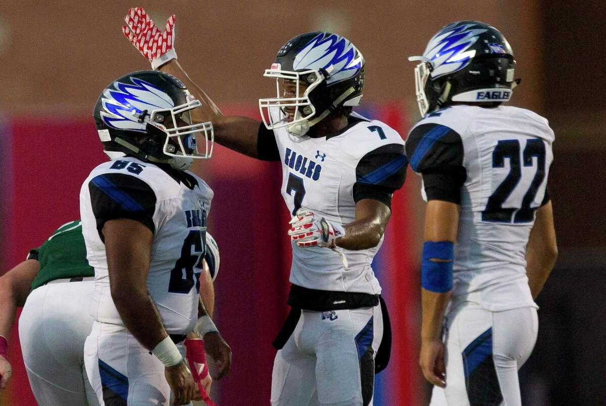 New Caney defensive back D'Juan Grant (7) reacts after defensive linemen Rodolfo Mayorquin (65) sacked Kingwood Park quarterback Hudson Dezell during the first quarter of a District 9-5A (Div. 1) high school football game at Turner Stadium, Saturday, Oct. 19, 2019, in Humble.