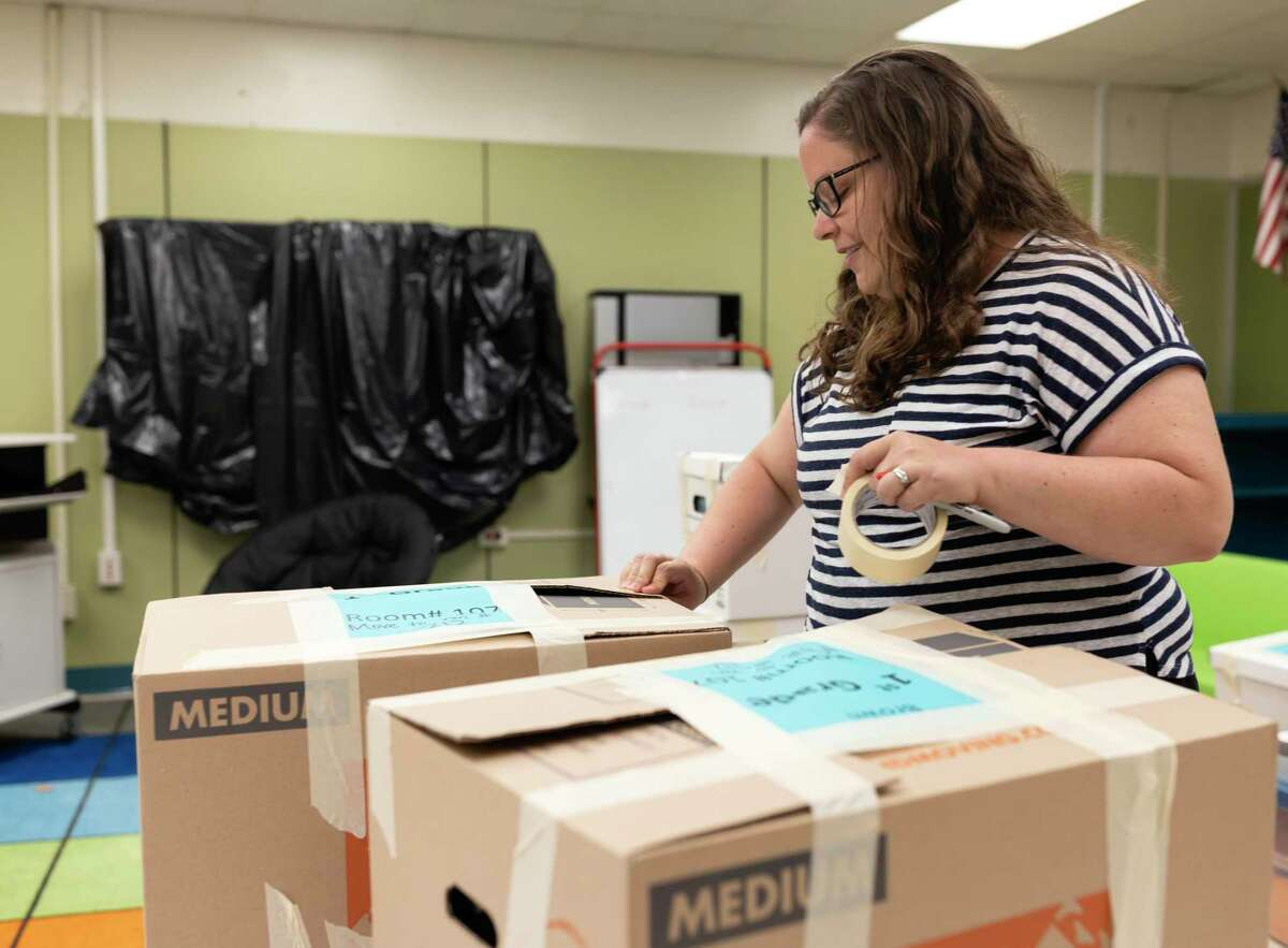 Heather Brown, first grade teacher at Peachcreek Elementary in Splendora tapes boxes of classroom material, Monday, May 4, 2020. Teachers have made adjustments to their curriculums in order to best serve their students through distance learning.