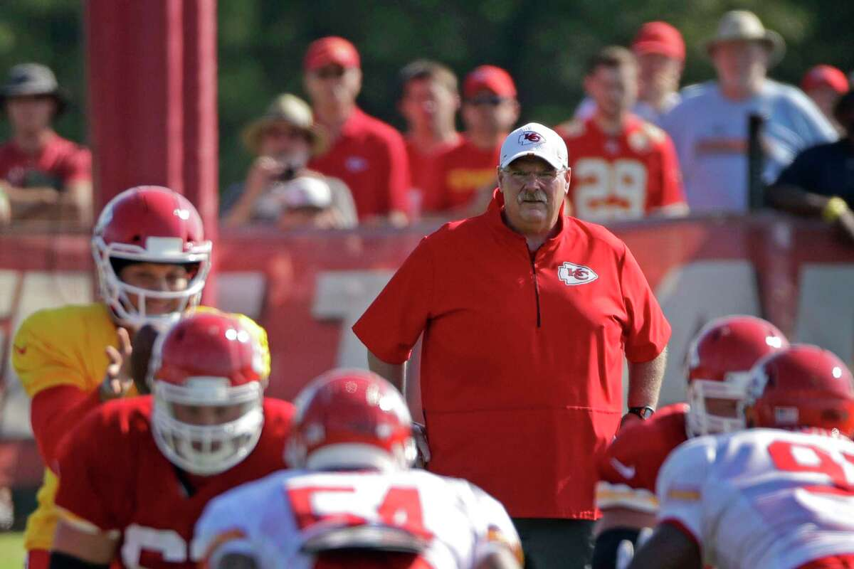 FILE - In this Monday, July 29, 2019, file photo, Kansas City Chiefs head coach Andy Reid watches a drill during NFL football training camp in St. Joseph, Mo. This was supposed to be the day that a bunch of wide-eyed rookies reported for their first training camp with the Kansas City Chiefs, lugging televisions and fans and other comfort items into the dormitories at Missouri Western State University. Instead, they were tested for COVID-19 and then sent home.(AP Photo/Charlie Riedel, File)